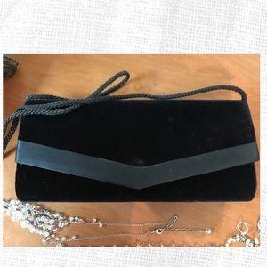 Black velvet clutch with inside mirror